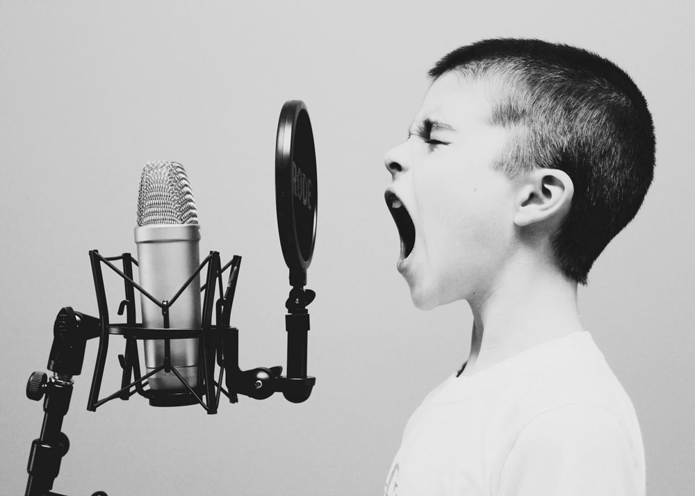 shouting into microphone