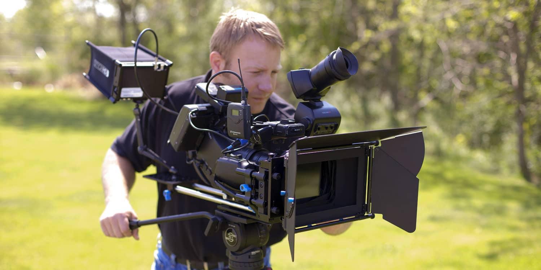 corey filming outside in field